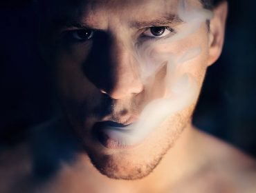 man with smoke in his mouth